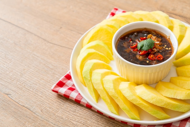 Fresh green and golden mango with sweet fish sauce dipping - asian style