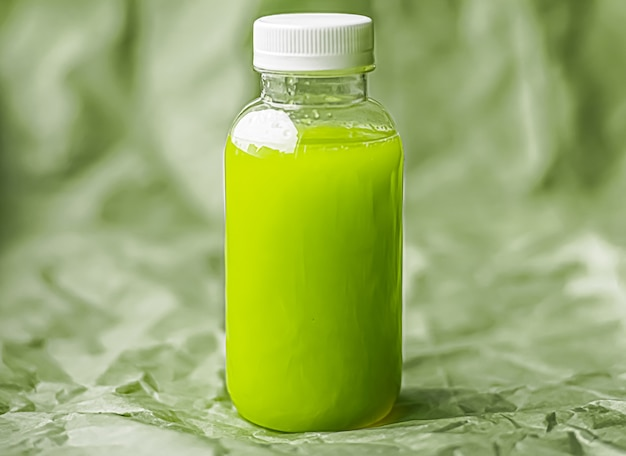 Fresh green juice in ecofriendly recyclable plastic bottle and packaging healthy drink and food prod...