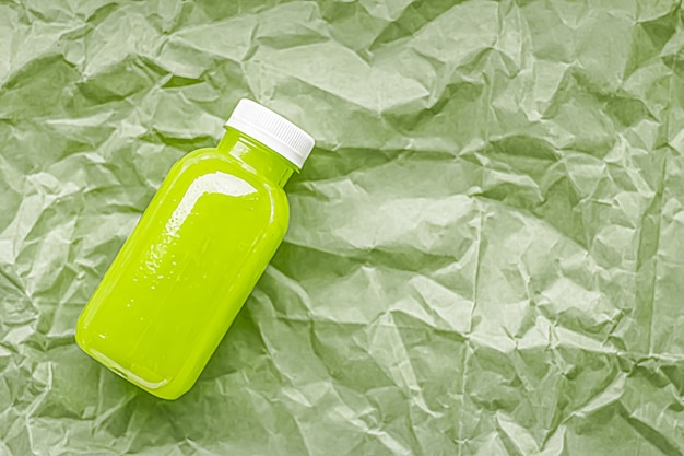 Fresh green juice in ecofriendly recyclable plastic bottle and packaging healthy drink and food product concept