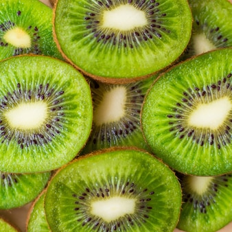 Fresh green kiwifruit background. flat lay, top view, food concept. food frame with copy space for your text. banner. green kiwi circles texture
