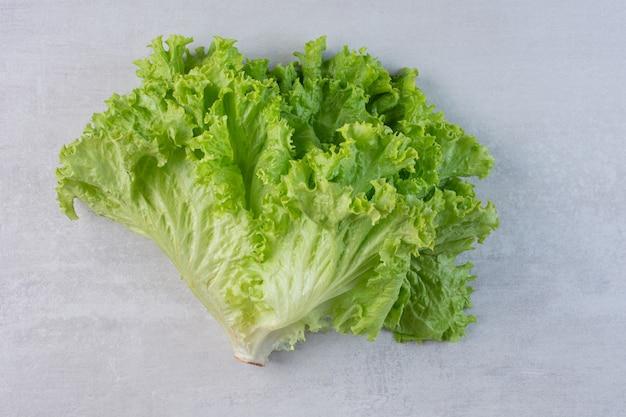 Fresh green lettuce on marble background. high quality photo