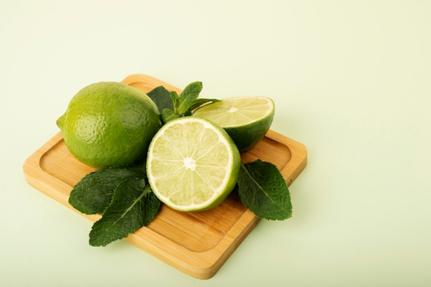 Fresh green limes on a pastel background