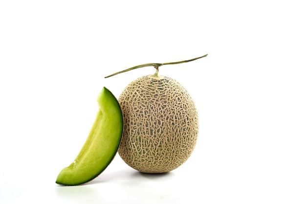 Fresh green melon and slice on white
