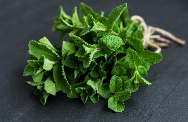 Fresh green mint on a black
