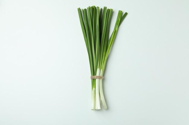 Fresh green onion on white