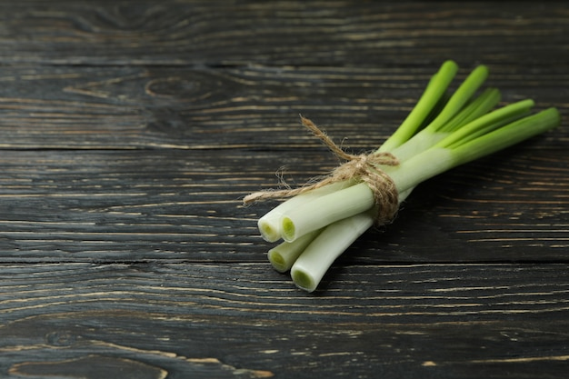 Fresh green onion on wooden table