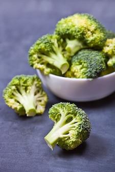 Fresh green organic broccoli in white bowl
