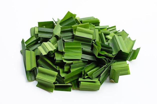 Fresh green pandan leaves on white