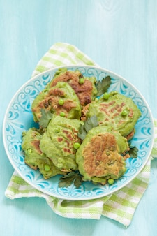 Fresh green pea fritters served with herbs