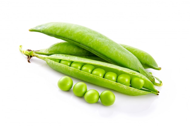 Fresh green pea pods and seeds isolated on white