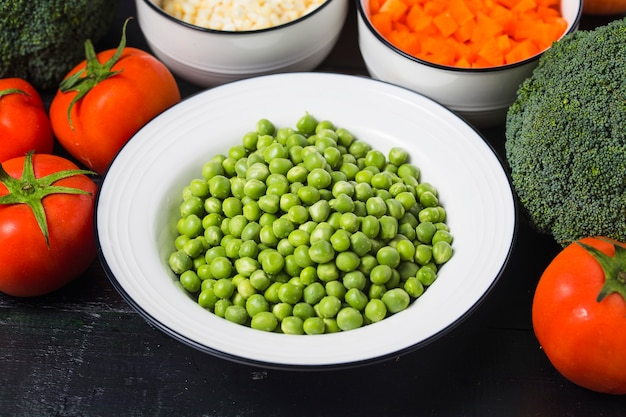 Fresh green peas and vegetables