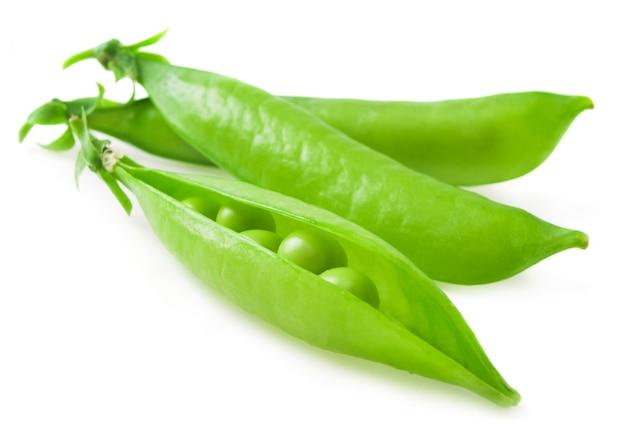 Fresh green peas on a white .