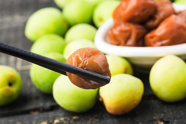 Fresh green plum and preserved green plum