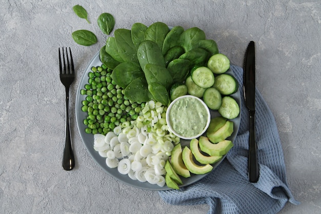 Fresh green salad on gray stone table