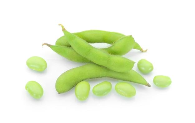 Fresh green soy beans on white