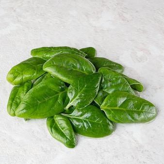 Fresh green spinach leaves, healthy food, copy space.