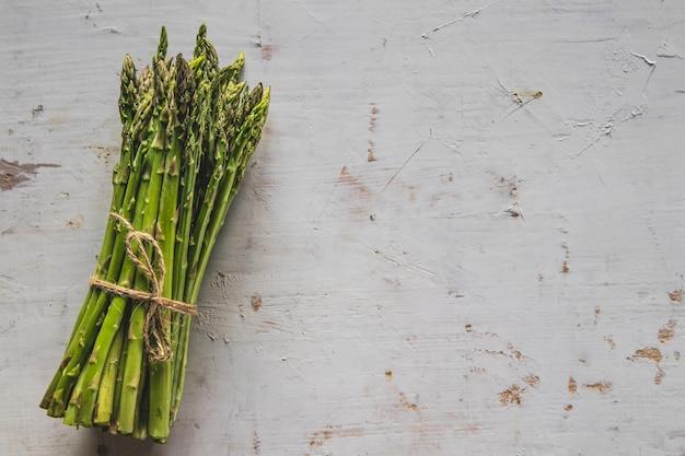 Fresh green spring asparagus on a wooden background. asparagus season