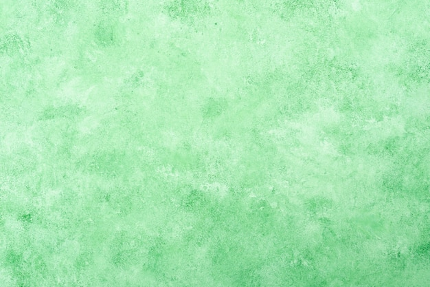 Fresh green textured stucco wall background