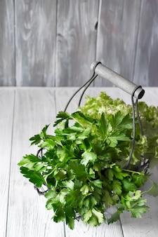 Fresh green vegetables in basket
