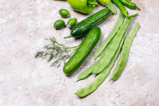 Fresh green vegetables on concrete surface