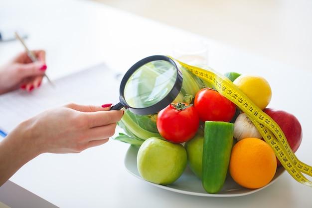 Fresh green vegetables, measuring tape