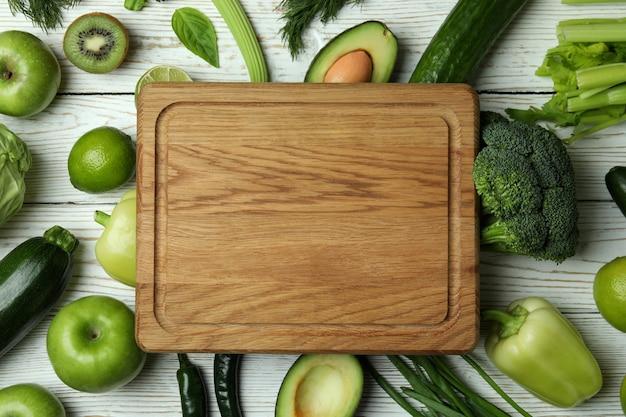 Fresh green vegetables on white wooden
