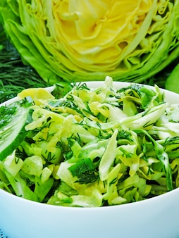 Fresh green vegetarian salad with young cabbage, cucumber and greens