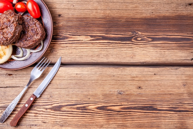 Fresh grilled beefsteaks with vegetables