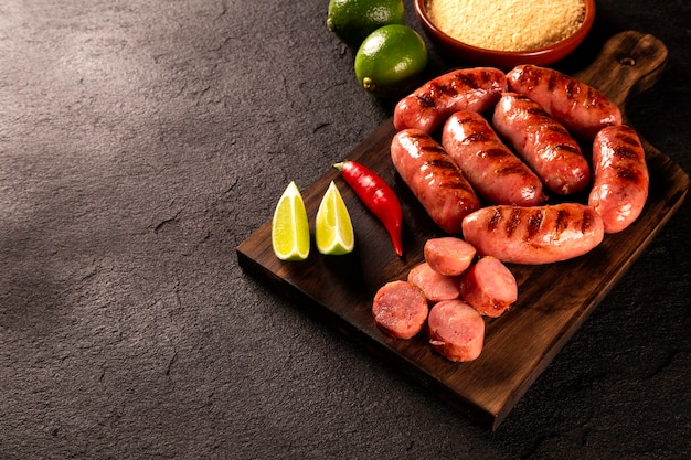 Fresh grilled pepperoni sausage. grilled pepperoni sausage on wooden board. top view.