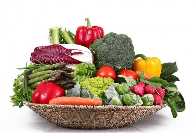 Fresh group of vegetables on white