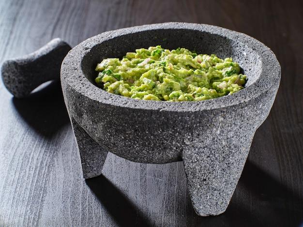 Fresh guacamole in stone molajete
