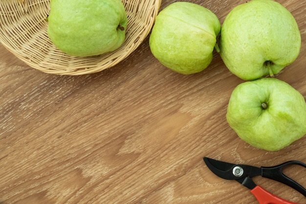 Fresh guava fruit. wood background space for add text.