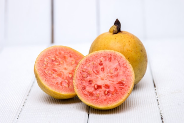 Fresh guava fruits on a white background.