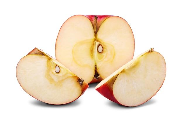 新鮮な半分と種子とリンゴの2つのスライス
