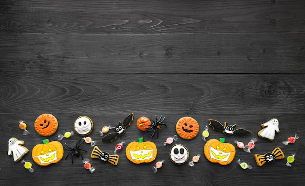 Fresh halloween gingerbread cookies on black wooden table delicious ginger biscuits for halloween