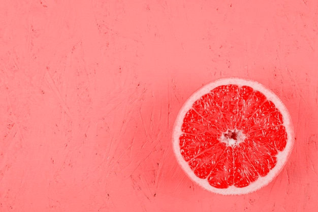 Fresh halved grapefruit on textured background