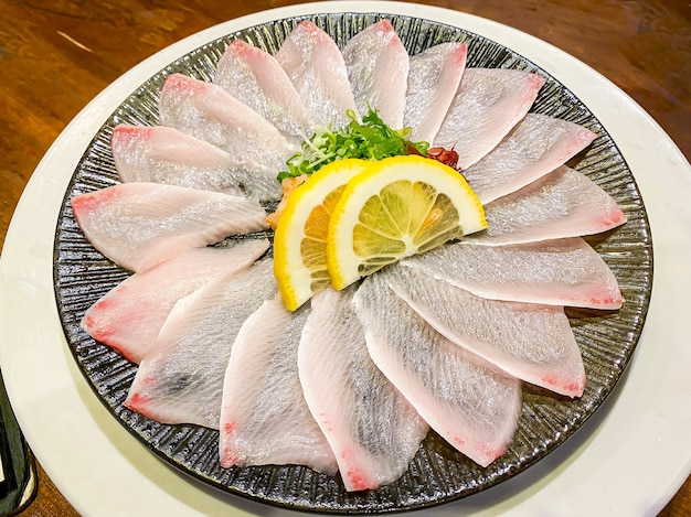 Fresh hamaji fish sashimi served on the table