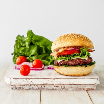 Fresh hamburger on wooden board