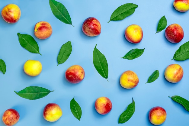 Fresh harvested nectarines lies on blue background vegetable vitamin keratin natural