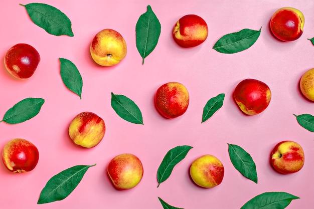 Fresh harvested nectarines lies on pink background vegetable vitamin keratin natural