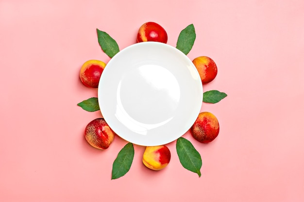 Fresh harvested nectarines lies on pink background vegetable vitamin keratin natural