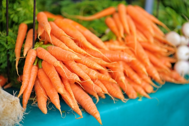 Fresh healthy bio carrots on paris farmer agricultural market