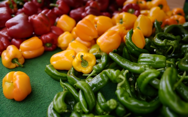 Fresh healthy bio red, yellow paprika and green pepper on farmer agricultural market