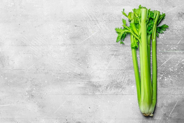 Fresh, healthy celery. on white rustic background