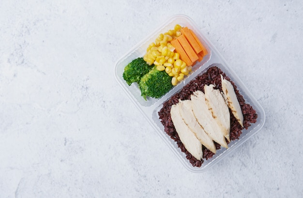 Fresh healthy diet lunch box with broccoli, carrot; corn and chia