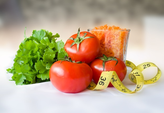 Fresh healthy dietary products, with centimeter tape,