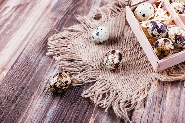 Fresh and healthy food, protein. quail eggs in wooden box stand on the rustic table