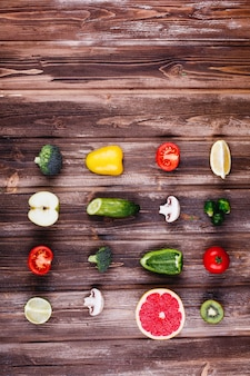 Fresh and healthy food. yellow and green pepper, lemon, lime, broccoli, tomatoes,