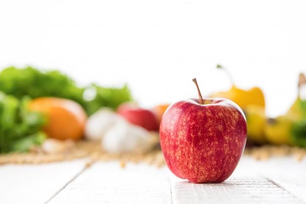 Fresh healthy gala apple on white wood table