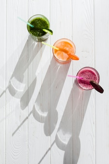 Fresh healthy juices with straws